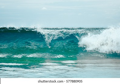 Close up photography of sea wave with sunny blue sky on horizon. Phuket sea wave, Thailand. Outdoor landscape of big ocean waves in Southeast Asia. Big ocean wave in Thailand. Huge tropical sea wave