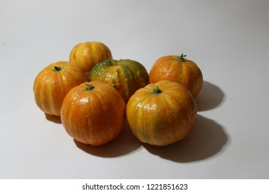 Close up photos of funny pumpkings citrus on white background