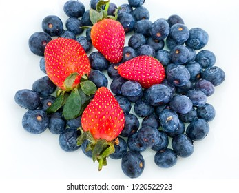 The close up photos of Malaysia local strawberry and chile blueberries for berries smoothies in the making...