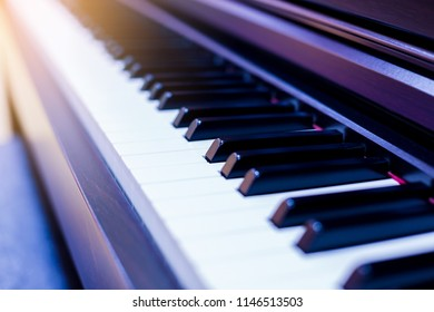 Close up to the piano keyboard background with selective focus. Classical music with black and white key.