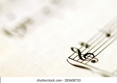 Close up of piano music score and notes and old paper