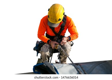 Close up pic of male rope access jobs  worker wearing yellow hard hat, long sleeve shirt, safety harness, working, at height abseiling down from high rise building with isolated white background