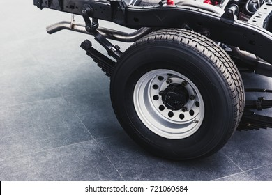 close up pickup truck rear tire with car chassis underbody clean new from factory