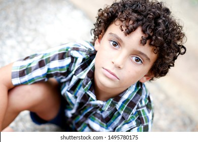 Close up picture of Beautiful Biracial African American Black Boy outdoor at nature park in the summer