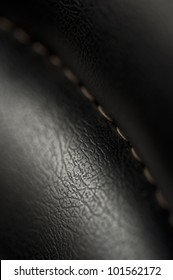 Close up picture of a black leatherette texture with stitch.