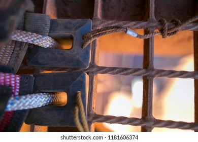 Close up picture of black rubber safety rope protection using against the sharp edge conner preventing rope cut, damage while abseiler abseiling construction high rise building Perth, Australia