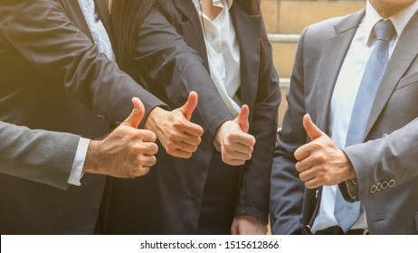 close up picture of businessmen showing thumb up. Team success, appreciation concept.