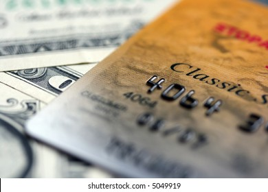 Close up picture of credit card putted on dollars