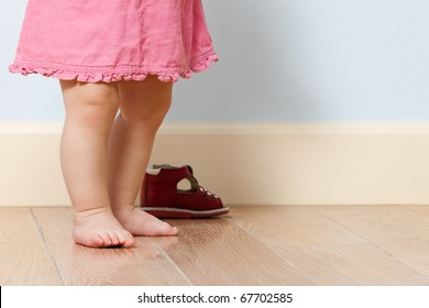 Close up picture of cute baby legs in a room