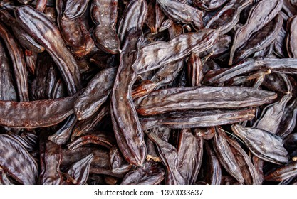 Close up picture of dried organic carobs.