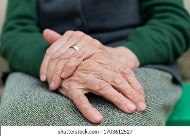 Close up picture of elderly hands of a widowed woman