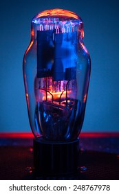 Close up picture of electronic vacuum tube,with incandescent filament and  blue background