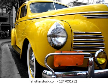 A close up picture from front left side of a retro yellow taxi car at Universal Studios, Florida March 22 2014.