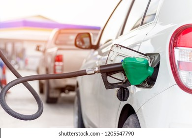 Close up picture of fuel monitoring system refueling a petroleum to vehicle at gas station.