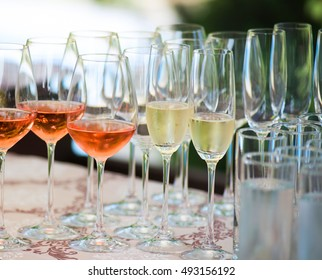 Close up picture of glasses with wine in restaurant.