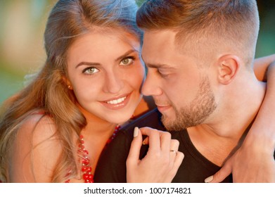 Close up picture of happy young couple hugging outdoors. Love, friendship and family concept