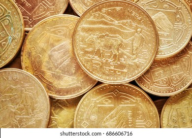 Close up picture of Nepalese rupee coins, shallow depth of field.