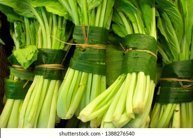 Close up picture of some celery (vegetable) wrapped and bundled in banana leaves. This is an excellent solution to replace plastic packaging and reduce the waist of it - Bali, Indonesia
