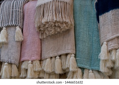 Close up picture of some pastel colored beautiful bohemian style rugs , located at the famous Love Anchor Market in Canggu, Bali - Indonesia