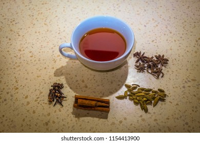 A close up picture with vignettes of tea preparation Nusantara style with cinnamon, cardamon, clove and staranise in a restaurant at Kuala Lumpur.