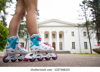 Close up picture of woman's legs with rollerskates
