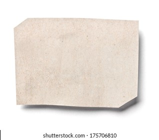 close up of a piece of newspaper on white background