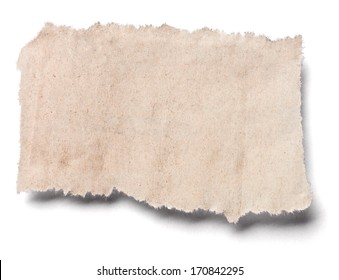 close up of a piece of ripped newspaper on white background