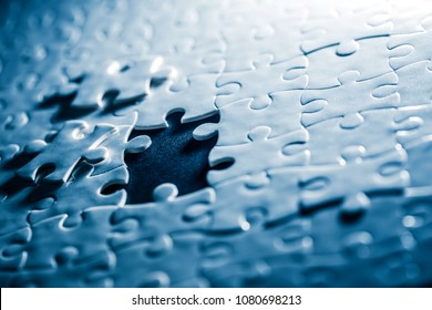 Close up piece of white jigsaw puzzle , concept of business challenge completion with teamwork