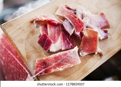 Close up of pieces of ham on a market stall