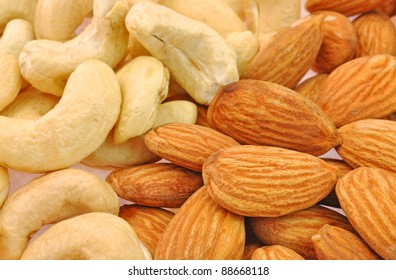 close up of pile of cashew nuts and almond