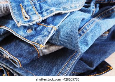 Close up of pile of folded denim blue jeans.