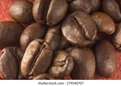 Close up pile of fresh aromatic coffee beans ready to brew