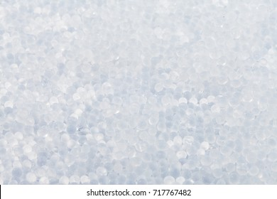 Close up - Pile of silica gel on white background, Desiccant used in industrial, moisture protection