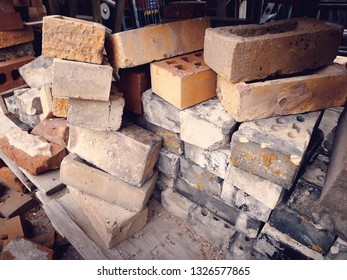 Close up of a pile of soft yellow bricks at a salvage yard in the UK.