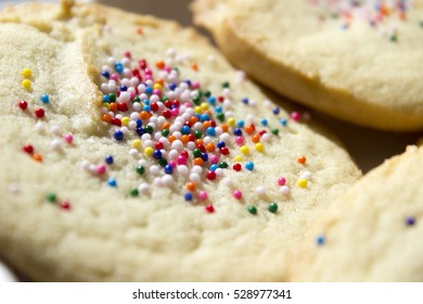 Close up of a pile of sugar cookies with sprinkles.