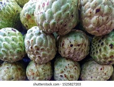 Close up pile of Thai custard apple  fruit or sugar apple fruit selling in the market. Background of sugar apple or custard apple.8