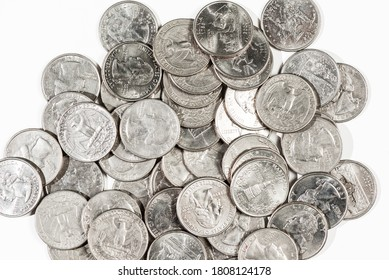 Close up of a pile of US quarters on white background