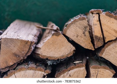 Close up of a pile of wood for splitting. Shallow depth of field.