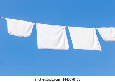 close up of pillow cases hanging for dry with the sun background with blue clear sky in summer season.