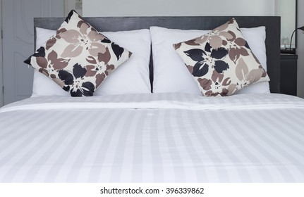Close up pillow on white bedding sheets