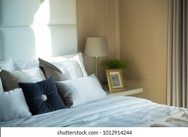 Close up pillows on bed in modern interior bedroom