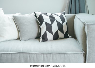 Close up pillows on comfortable sofa in living room