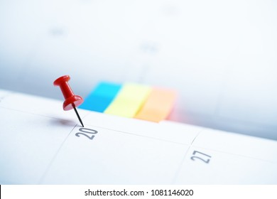 close up of pin on calendar planning for business meeting or travel planning concept