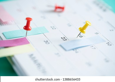 close up of pin on calendar, planning for business meeting or travel planning concept