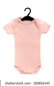 Close up of a pink baby onesie on a hanger isolated e9281b473