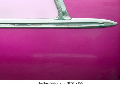 Close up of a pink door of a 1950's classic car, in Havana, Cuba.