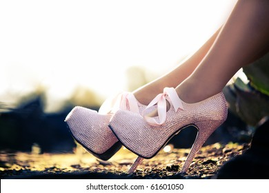 Close up of a pink high heels with little diamonds
