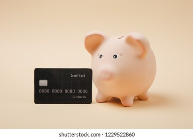 Close up of pink piggy money bank and black credit card isolated on beige wall background. Money accumulation, investment, banking or business services, wealth concept. Copy space advertising mock up
