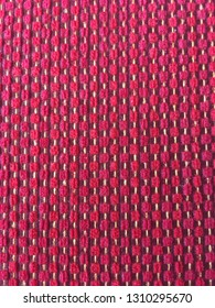 Close up of pink and red textured fabric