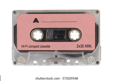 Close up pink retro cassette tape from the 80s, isolated on white background. Retro  cassette tape.